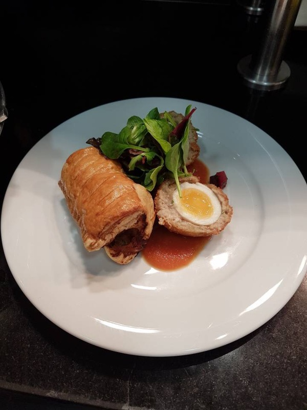 Scotch egg, sausage roll, beetroot and potato salad, tomato coulis