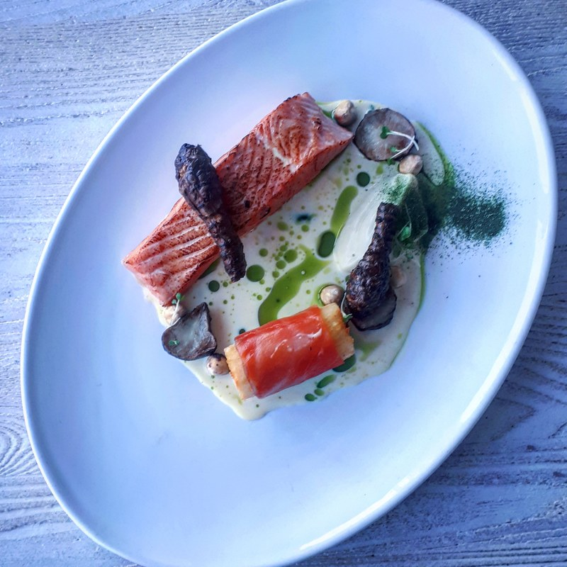 Torched 40°c irish salmon, Jerusalem artichokes, potato and smoked salmon roll, hazelnuts, parsley, chowder sauce