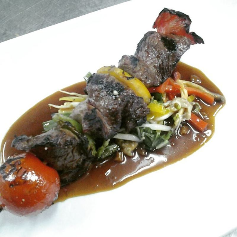 Beef kebab on stir fried veg