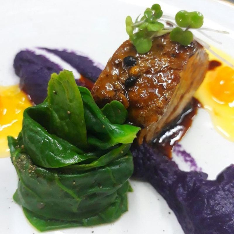 Roasted pork loin,wilted spinach and purple potato puree