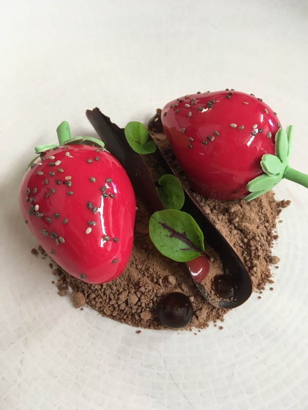 Dessert featured in Thai years Masterchef Professionals opening credits Valrhona Orelys whipped ganache filled with a strawberry & liquorice compote, strawberry gel, liquorice syrup, sorrel