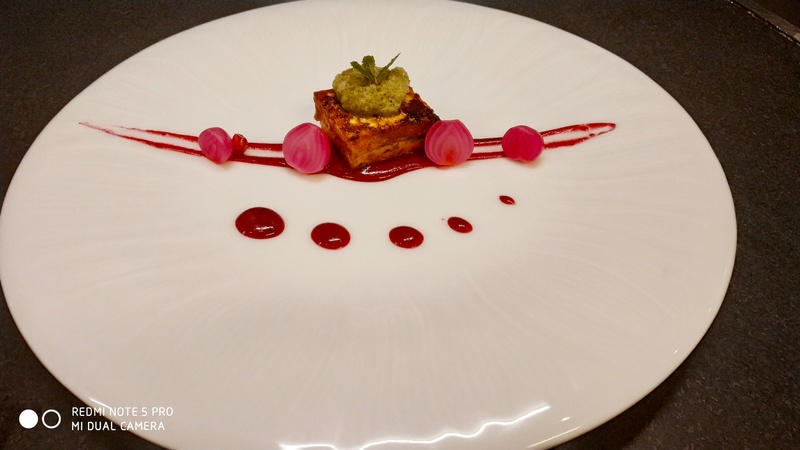 Paneer tikka with beetroot chutney shirka onion,and mint foam.