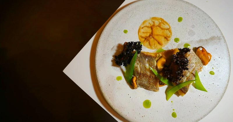 Local seabass, caramelized sweet potato puree, mussels, kale chips and garlic chives oil. #localingredients