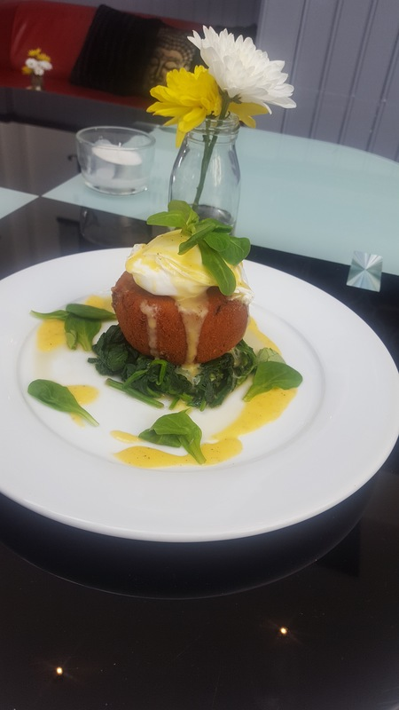 Wild mushroom arancini, wilted spinich topped with a poached egg and hollandaise sauce.
