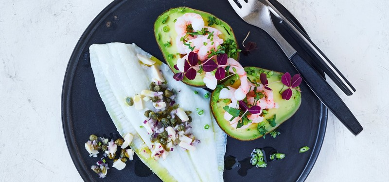Steamed plaice fillet with baked avocado and prawns