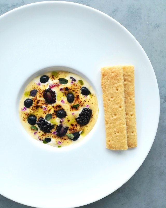 Forest berries & tonka sabayon, basil blossoms, coconut shortbread.