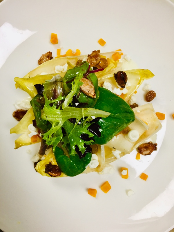 Braised Endive and Greens, brown butter vinaigrette, Calabaza, whipped Goat cheese, Calabaza seeds