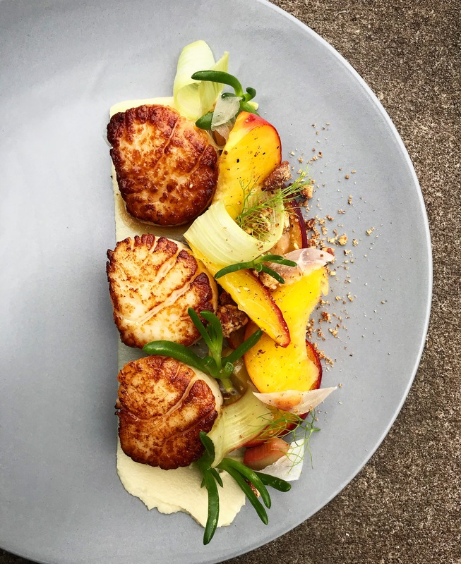 Scallops with sweet tea compressed peach/ creamed parsnip/ candied pecans/ salicornia