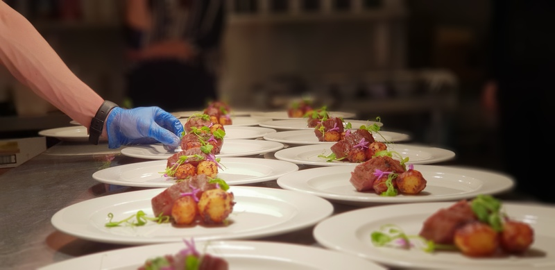 Plating up the fillet of beef