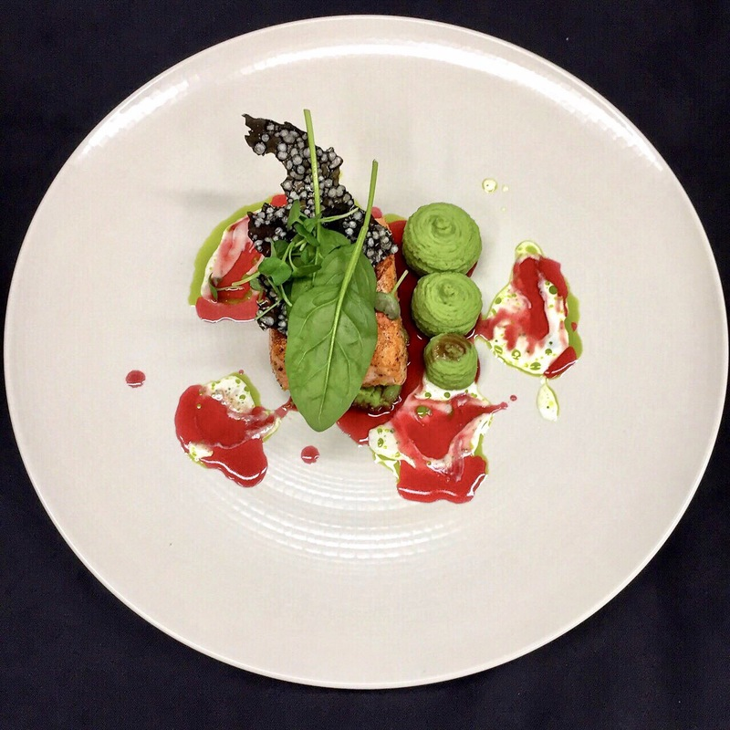 Salmon sous-vide with peas, wasabi puree with cherry-pomegranate sauce