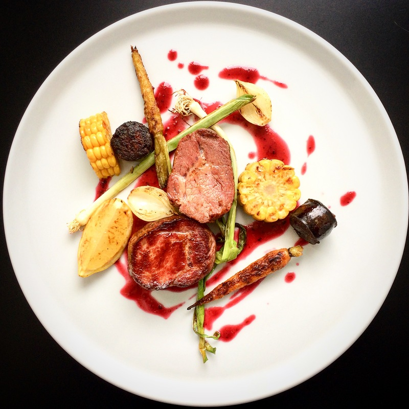pork tenderloin / loin medallion / crispy black pudding / roasted corn / caramelized carrot / fried shallots / leek / cherry and raspberry sauce
