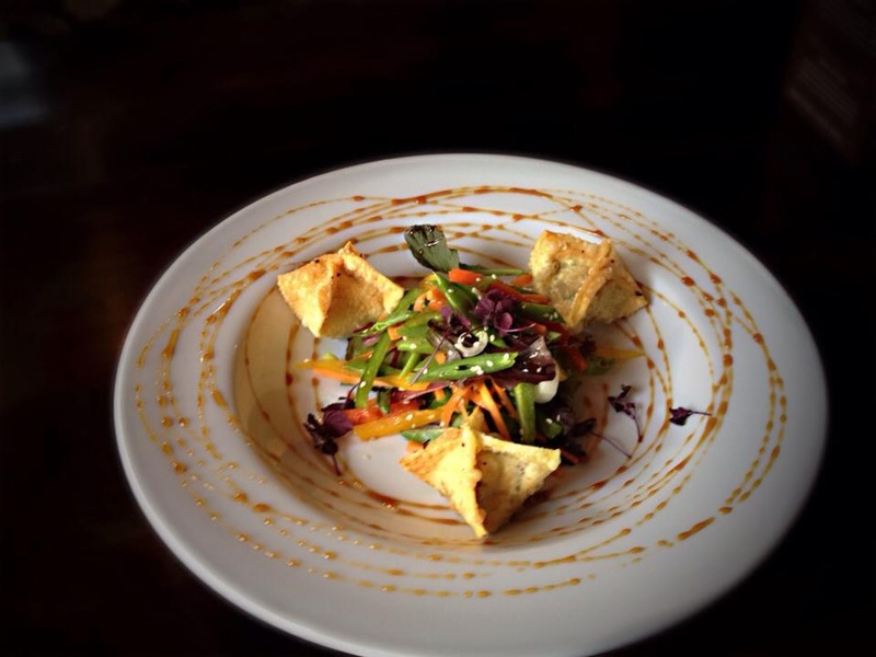 Duck wonton salad - mange tour, carrot, pomegranate molasses