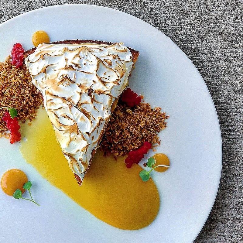 Gluten free almond sponge•swiss meringue•charred orange curd•toasted coconut•raspberry