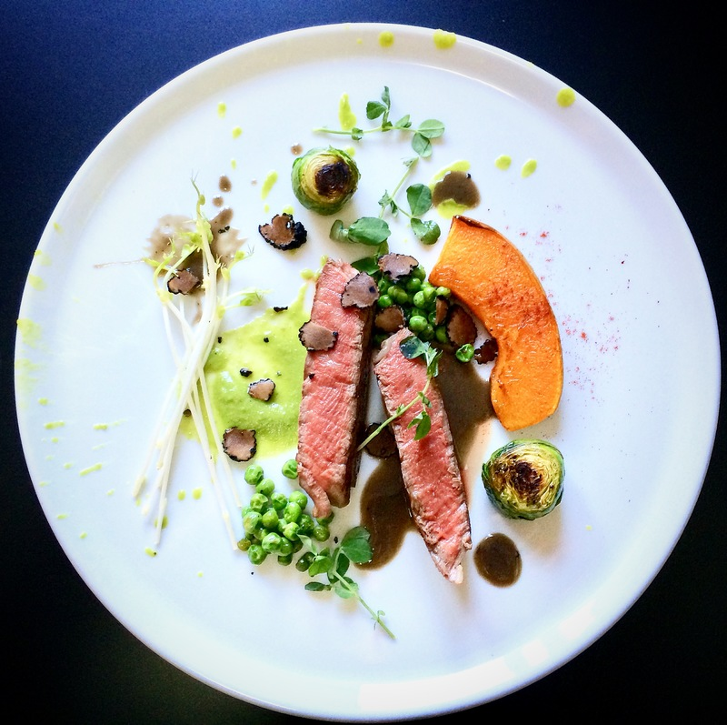 Entrecôte Angus sous vide / pea cream / pumpkin roasted and grilled in sage butter / portobello mushroom reduction / pea sprouts / pea leaves and  peas / black truffles / roasted Brussels sprouts