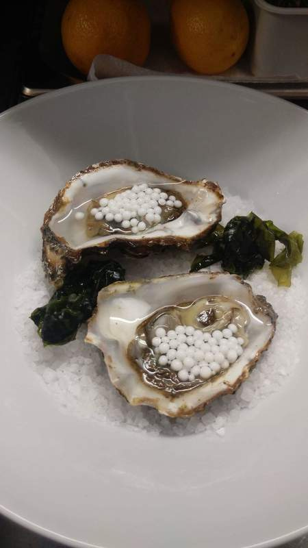 Oysters with coconut milk caviar..