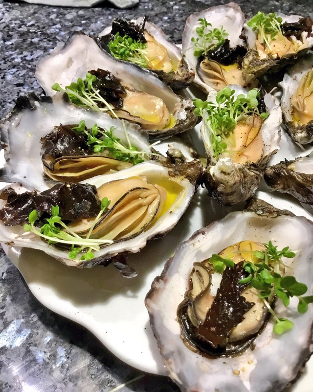 Steamed oysters in red wine, dulse confit,cress,Evo