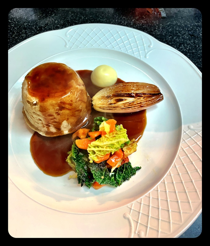 Steamed venison pudding, Savoy cabbage, parsnip purée and roasted shallot