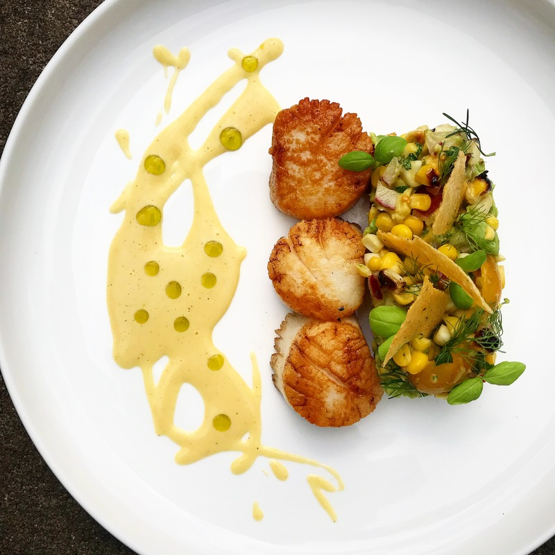 Scallops/ charred polenta cake/ roasted corn and legumes/ basil oil