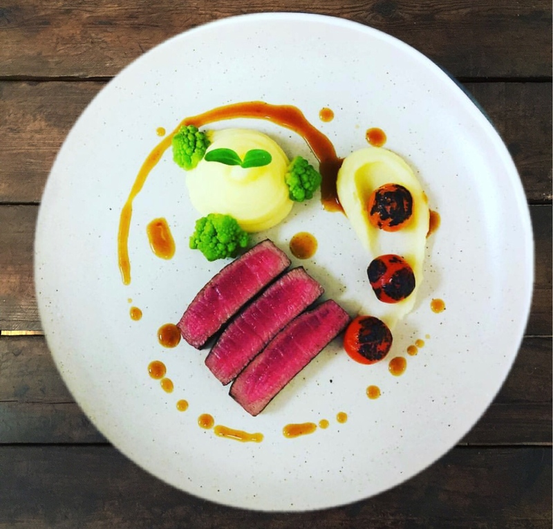 Beef fillet, Robuchon potatoes, charred tomatoes & romanesco.