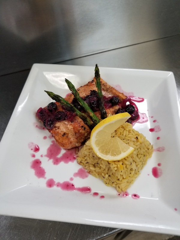 Pan seared salmon with asparagus, rice pilaf and blueberry reduction sauce