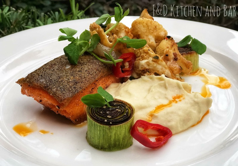 Seared Artic Char, caught off the coast of Alaska   Served with cauliflower mash, roasted cauliflower, roasted leeks,lobster sauce. Finished off with Fresno peppers