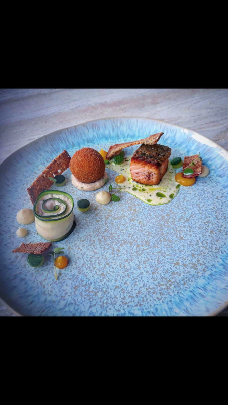 Salmon trilogy: seared, smoked, cake, lemon puree, courgette, chive
