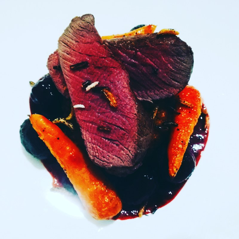 Venison loin, roasted beets and carrots and a blackcurrant saucr