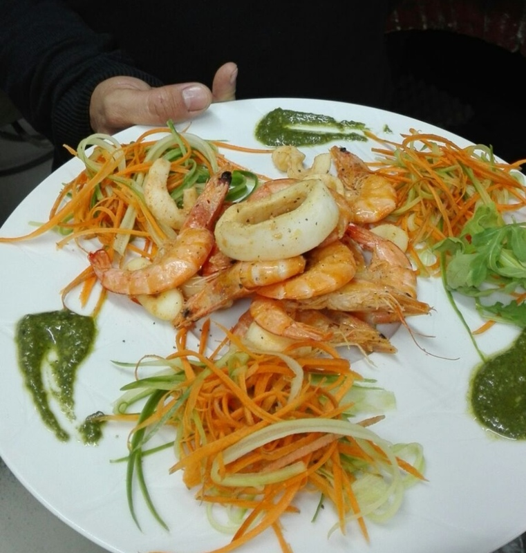 Shrimps and squids with vegetables carpaccio and pesto.