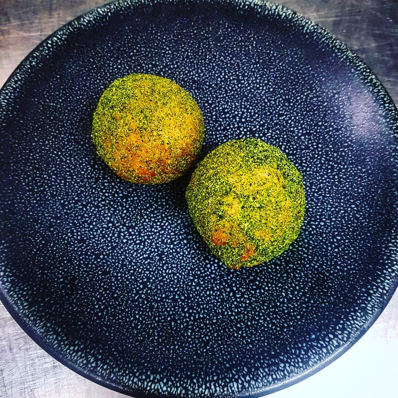 New canapé, spenwood fondue sourdough doughnut, chive and poppy seed powder