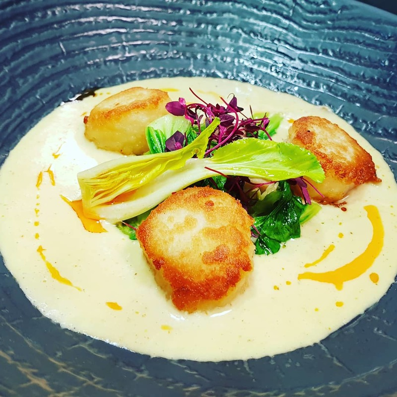 Ajo Blanco, paneed hand dived king scallops, iberico chorizo oil with sauteed greens.