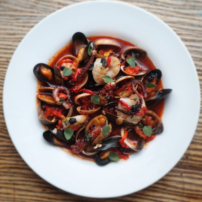 Mussels, clams, cockles, octopus, prawns, steamed in a red pepper and tomato broth, tomato and caviar dressing, roast red peppers, oregano and thyme.