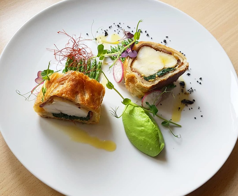 """Monkfish Wellington""  Slavonian black pig ham•young spinach•wild garlic•chili•pine nuts•fava beans puree•wild asparagus... #tbt2018"