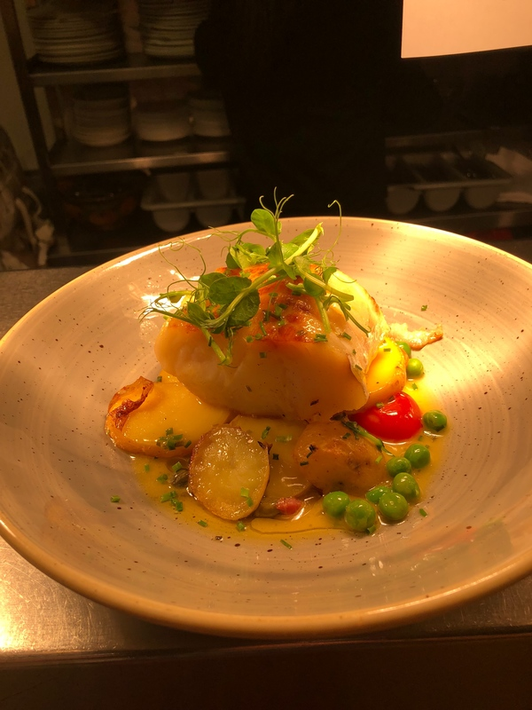 Hake roasted baby potatoes peas, bacon