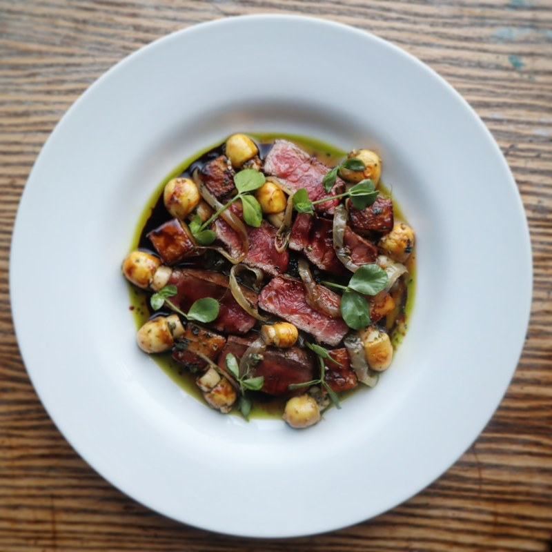 Smoked flat iron steak, new potatoes, horse mushrooms, aged balsamic and truffle oil.