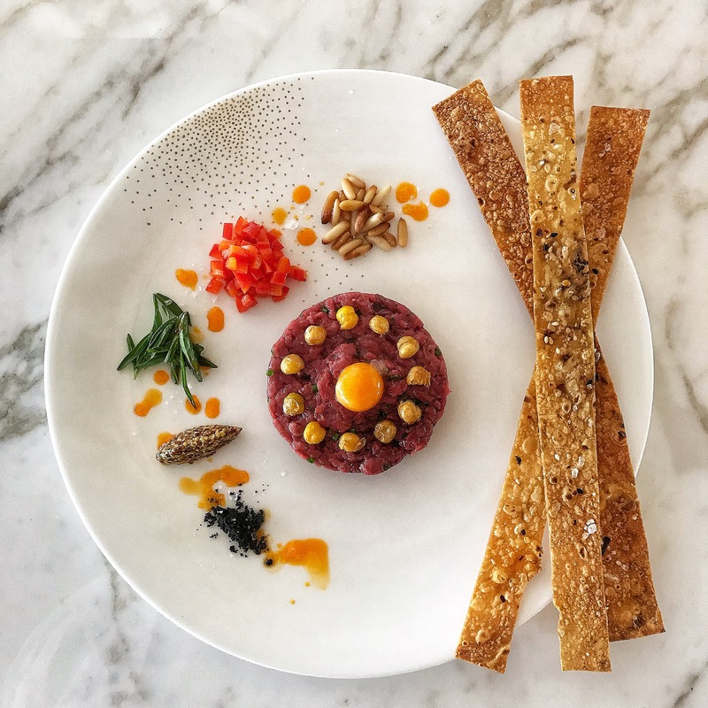 Camel tartare :camel:  Crispy chickpea, quail egg, pickled peppers, sumac, dried olive, fresh za'atar, pine nut and chili :hot_pepper: