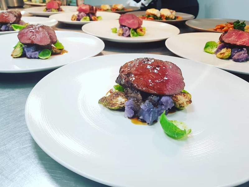 Veal fillet SV in onion ashes, pickled and buttered sprouts, purple potatoes ao murro and veal black mustard demi glace.