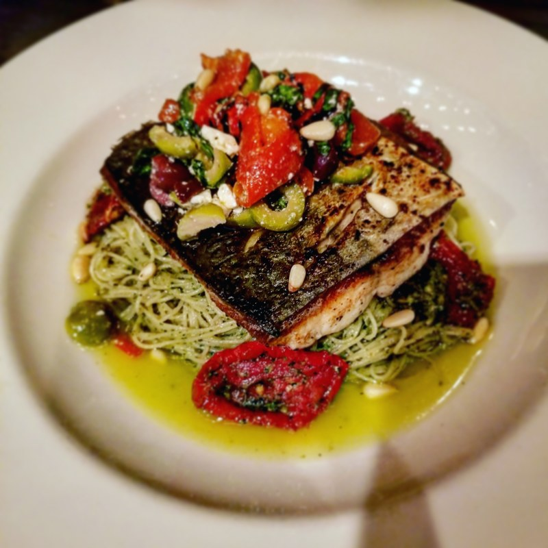 Spanish Mackeral with roasted pepper and olive tapenade, pesto, sun dried tomato, and capellini