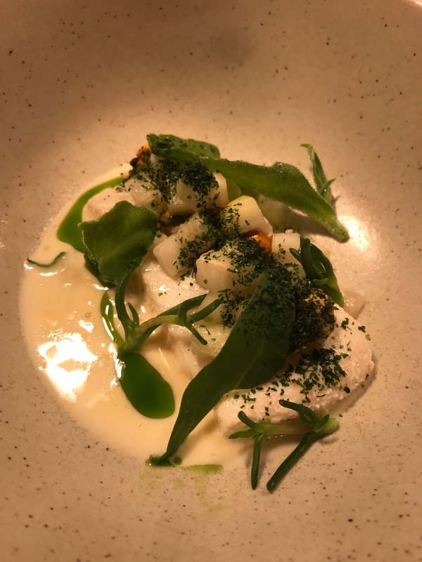 Scottish Butter Poached Halibut, pickled mussels and cucumber, sea herbs, Roasted fish stock emulsion
