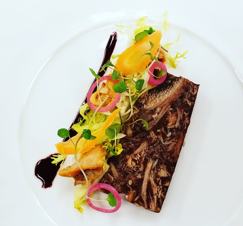 Coq Au Vin Terrine...port reduction, chicory, pickled chanterelle, red onion, shaved carrot  @cafebouludto by @ntrosien