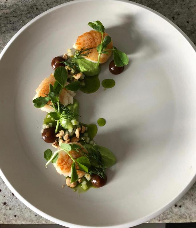 Home cook (Dish #2) scallops, pea purée, burnt apple purée, pickled apple, hazelnuts, basil oil and pea shoots (Instagram davidjrickett)