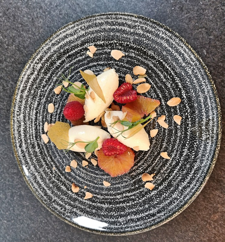 Whipped goats cheese, almond praline, raspberry, red wine and cardamon compressed orange
