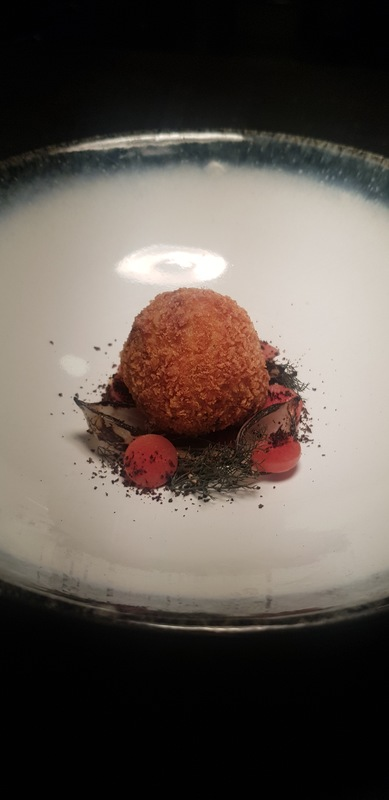 Oxtail...  A crispy ball of shredded tail meat with the richest beef consomme