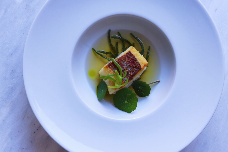 The fish course from our last tasting menu. Pan fried merluza, fuet consommé, garden herb oil, local samphire, salty fingers, nasturtiums.... thank you @la_luna_soller for the amazing fuet :heart_eyes: