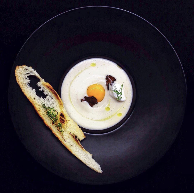 Cauliflower cream soup with truffles and egg yolk