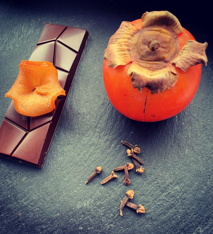 LIQUORICE & PERSIMMON  A 70% bean-to-bar chocolate made with dark muscavado sugar & Lakrids liquorice syrup. Persimmon confit in a vanilla, clove & black peppercorn syrup.