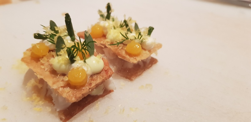 Haddock sandwich: Chicken skin biscuit, poached haddock, confit egg yolk puree, smoked creme fraiche, pickled samphire.