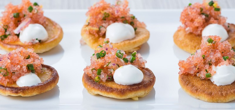 Lumpfish roe with blinis and red onions
