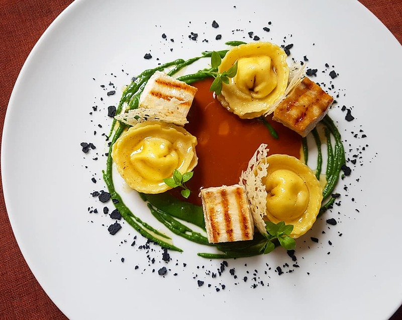 Smoked sea bream/ricotta tortellini•grilled swordfish•spinach puree•roasted langoustine bisque•truffle cheese tuille...