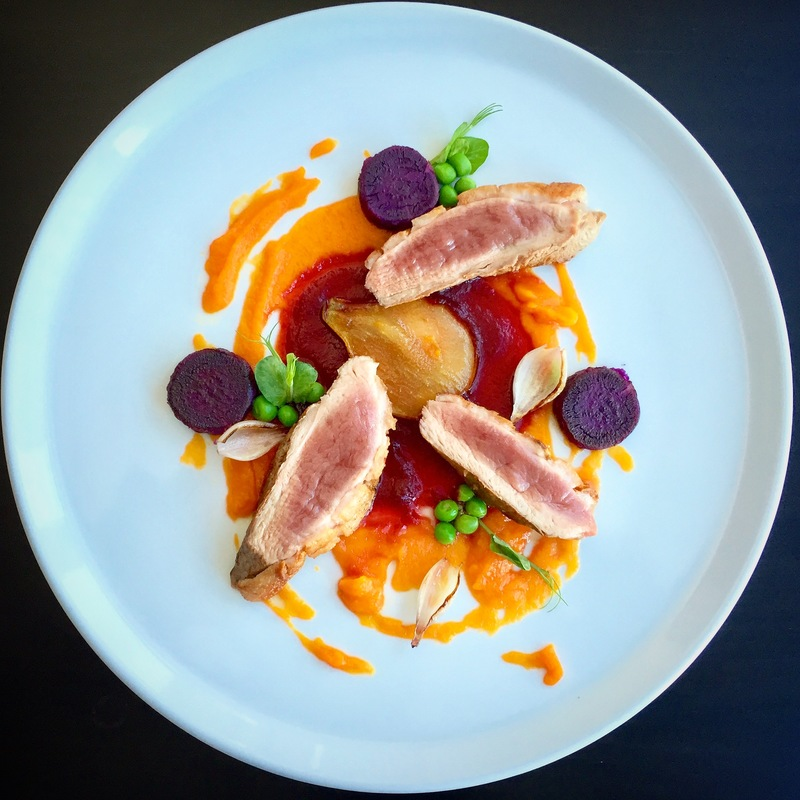 Duck breast | carrot puree with orange | smoked beet sauce | burned onions | peas | dehydrated pear leaf | purple sweet potato.