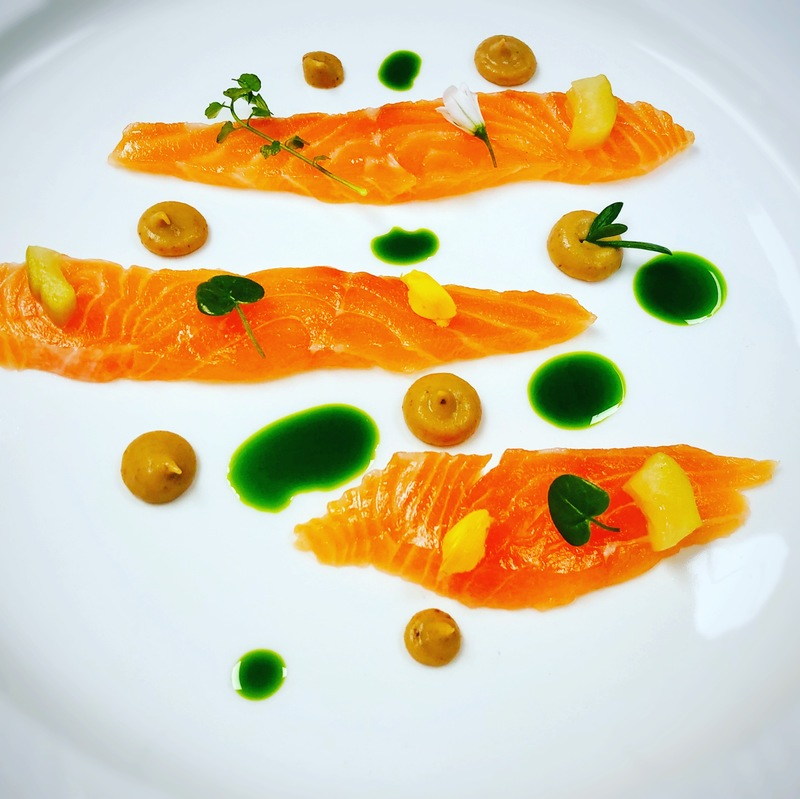 Cured salmon, pickled cucumber, smoked pear purée, sea herbs